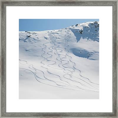 Ski Tracks In The Snow On A Mountain Framed Print by Keith Levit