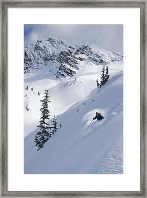 Skier Hitting Powder Below Nak Peak Framed Print by Kurt Werby