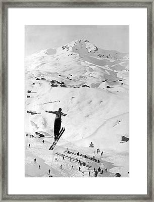 Skier Leaping Over A Valley Framed Print