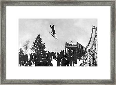 Skier Off A Jump Framed Print by Underwood Archives