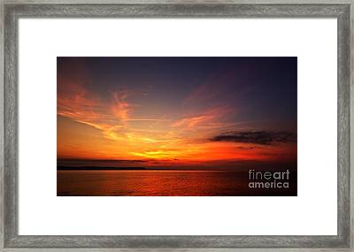 Skies On Fire Framed Print by Baggieoldboy