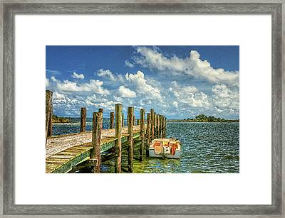 Skiff And Pier Framed Print