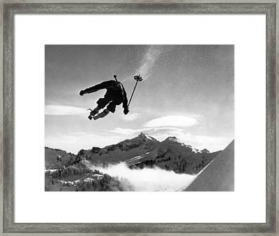 Skiing Over Mt. Ranier Framed Print by Underwood Archives