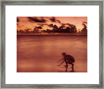 Skimboarding At Dawn Framed Print by Timothy Lowry