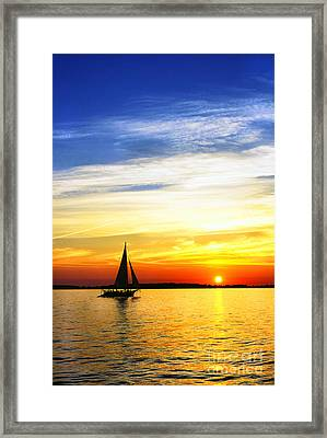 Skipjack Under Full Sail At Sunset Framed Print by Thomas R Fletcher