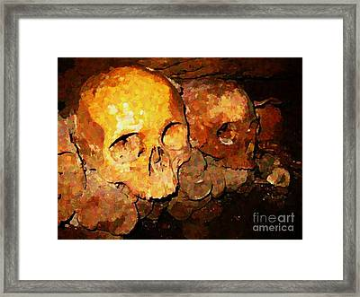 Skulls In The Paris Catacombs Framed Print by John Malone