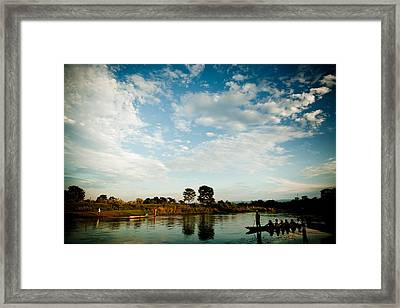 Sky And River Wuth Boat Framed Print by Raimond Klavins