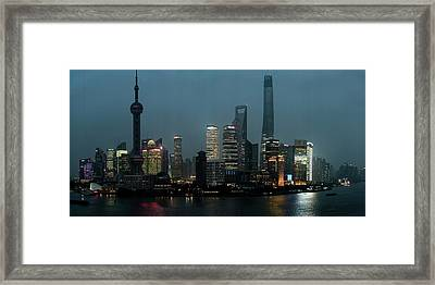 Skylines At The Waterfront At Night Framed Print by Panoramic Images