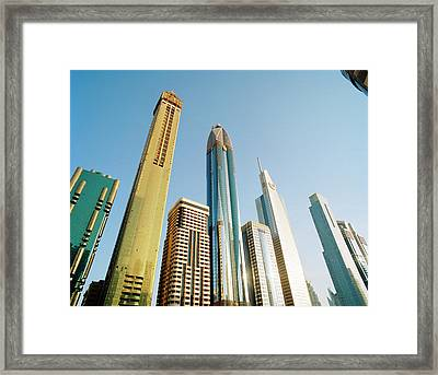 Skyscrapers Along Sheikh Zayed Road At Framed Print by Gary Yeowell