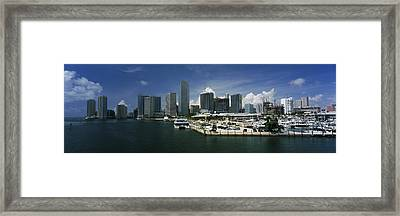 Skyscrapers At The Waterfront Viewed Framed Print by Panoramic Images