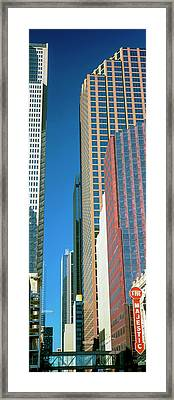 Skyscrapers In A City, Majestic Framed Print by Panoramic Images