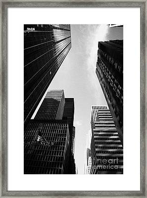 Skyscrapers With Stars And Stripes Flying Rockefeller Plaza Center New York City Framed Print by Joe Fox