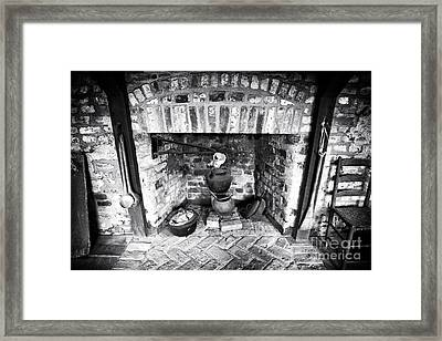 Slave Cooking Framed Print by John Rizzuto
