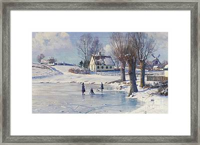 Sledging On A Frozen Pond Framed Print by Peder Monsted