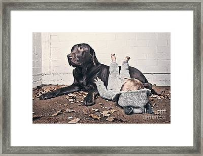 Sleeping Baby With Dog Framed Print by Justin Paget