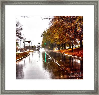 Framed Print featuring the photograph Slick Streets Rainy View by Lesa Fine