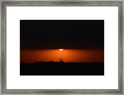 Sliver Of A Sunset Framed Print