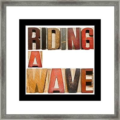 Slogan Riding A Wave Framed Print by Donald  Erickson