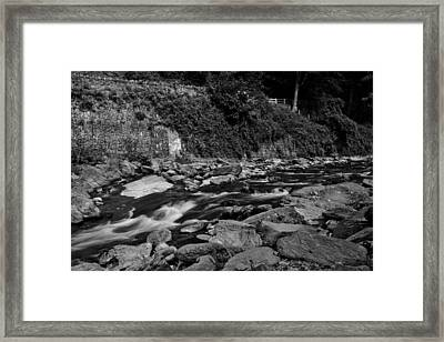Slow River Framed Print by Lesley Rigg