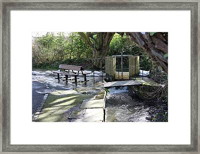 Sluice Gate With Sandbag Defences. Framed Print by Sheila Terry