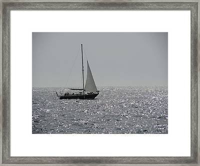 Small Boat At Sea Framed Print