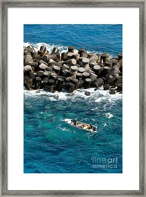 Small Boat Off Nassau Shore Framed Print by Amy Cicconi