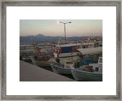 small boats at sunset in Corinthos         Framed Print