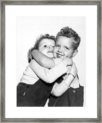 Small Boy Hugging His Sister Framed Print by Ed Estabrook