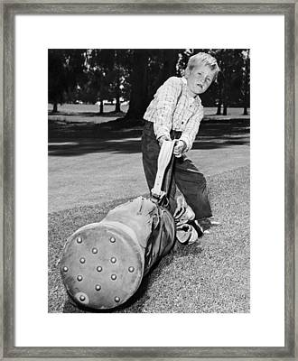 Small Boy Totes Heavy Golf Bag Framed Print by Underwood Archives
