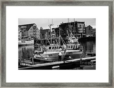 small local fishing boats in Tromso harbour troms Norway europe Framed Print