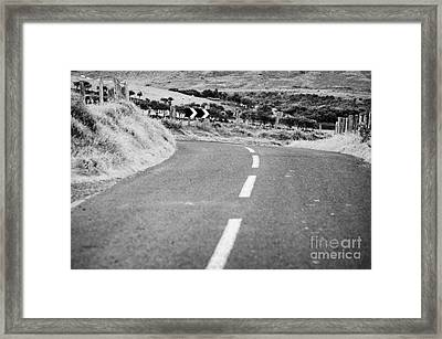 Small Narrow Country Road Leading To Dangerous Bend In County Antrim Northern Ireland Framed Print by Joe Fox