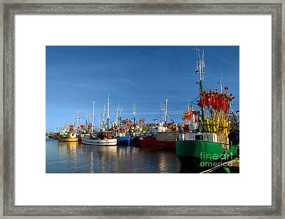 Small Ships In A Charming Harbor Framed Print