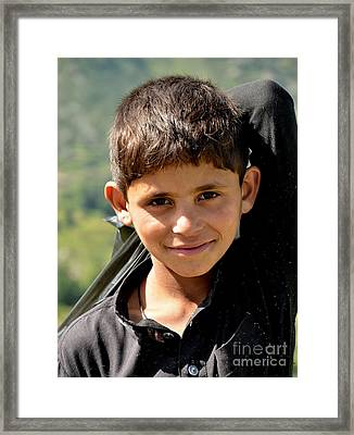Framed Print featuring the photograph Smiling Boy In The Swat Valley - Pakistan by Imran Ahmed