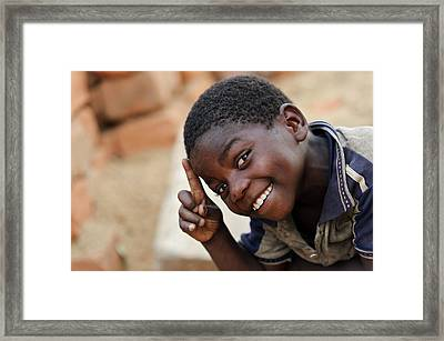 Smiling Boy Framed Print by Matthew Oldfield