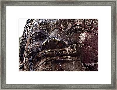 Smiling Faces Of Bayon Framed Print by Joerg Lingnau