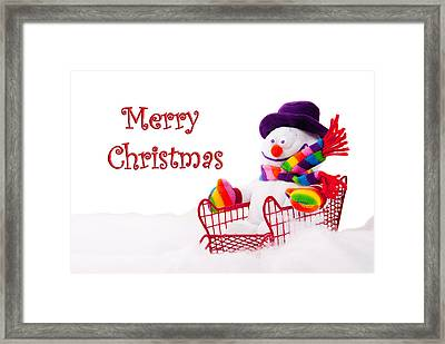 Framed Print featuring the photograph Snowman Riding In A Red Sleigh - Christmas  by Vizual Studio