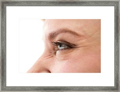 Smiling Woman's Eye Framed Print by Daniel Sambraus, Thomas Luddington