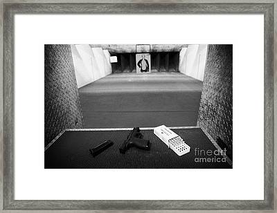 Smith And Wesson 9mm Handgun With Ammunition At A Gun Range In Florida Framed Print by Joe Fox