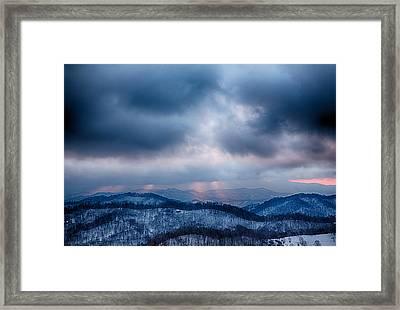 Smoky Sunset Framed Print by John Haldane