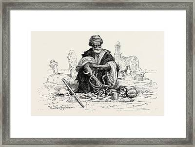 Snake-charmer.  Snake Charming Is The Practice Framed Print by Litz Collection