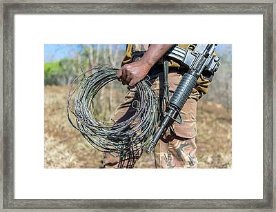Snares Found In Anti-poaching Patrol Framed Print by Peter Chadwick