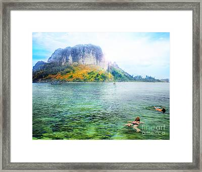 Snorkeling  Framed Print by Anek Suwannaphoom