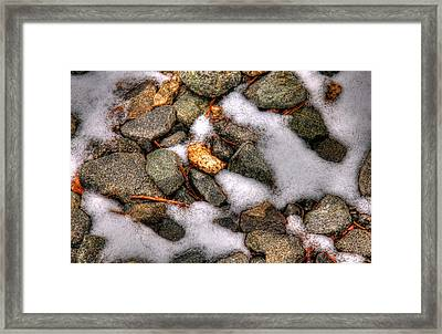 Snow Among The Rocks Framed Print by Andy Lawless