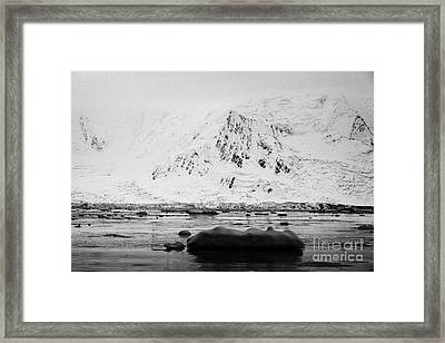 snow covered Anvers Island and Fournier Bay Antarctica Framed Print by Joe Fox