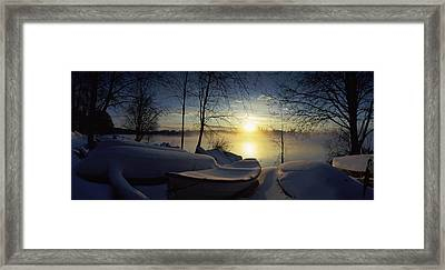 Snow Covered Boats At The Riverside Framed Print