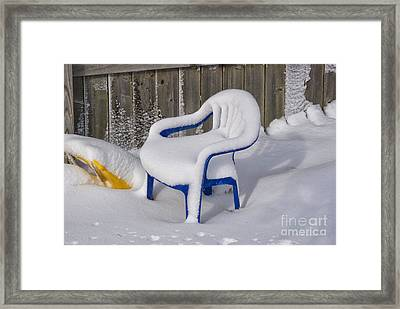 Snow Covered Chair Framed Print by Thomas Woolworth