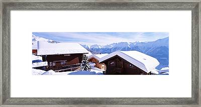 Snow Covered Chapel And Chalets Swiss Framed Print by Panoramic Images