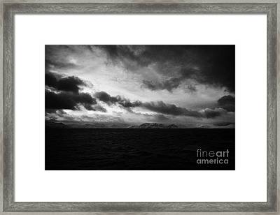 Snow Covered Cliffs And Rugged Arctic Coastline Northern Norway Europ Framed Print by Joe Fox