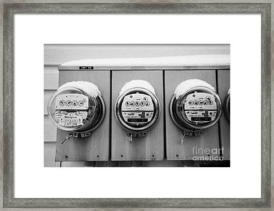snow covered electricity meters in Saskatoon Saskatchewan Canada Framed Print