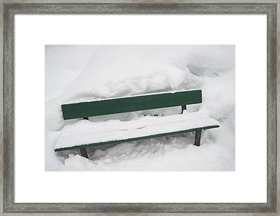 Snow-covered Green Bench In Winter With Lots Of Snow Framed Print